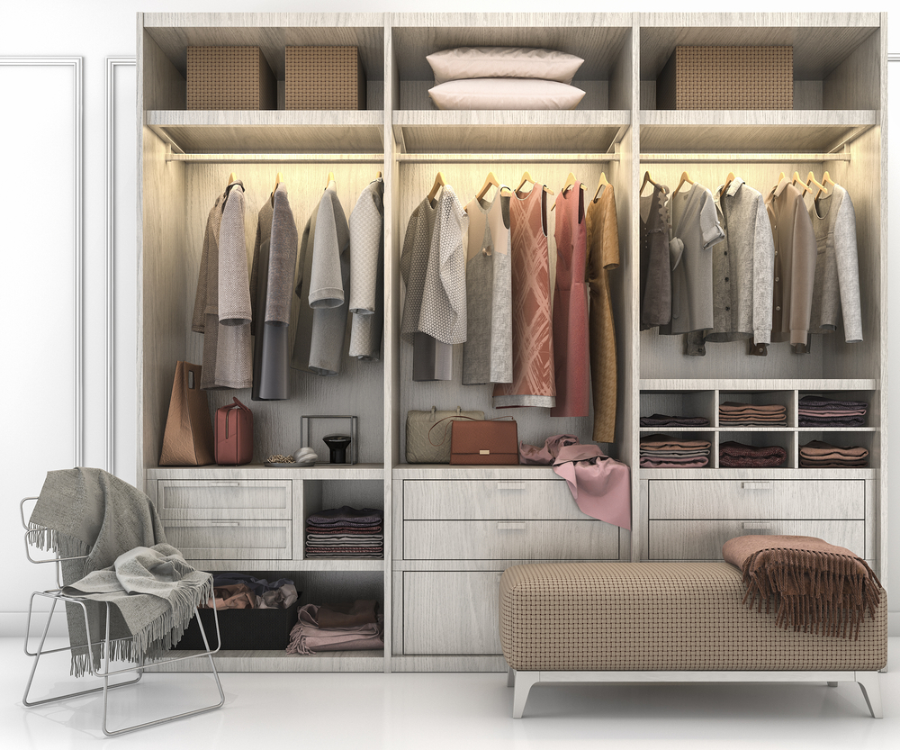Many of us feel drawn to the look of a minimalist closet. Your closet may be stuffed to the gills, but there are steps you can take to create the minimalist look you desire. #designyourhappyplace #closetenvy