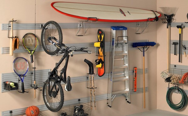 Now that summer is here it is very likely that your children will be spending more time playing outside. Which also means that in no time, your garage will turn into a pile of swim things, sports gear, toys, and who knows what else. These tips will help you create a garage organization system for summer!