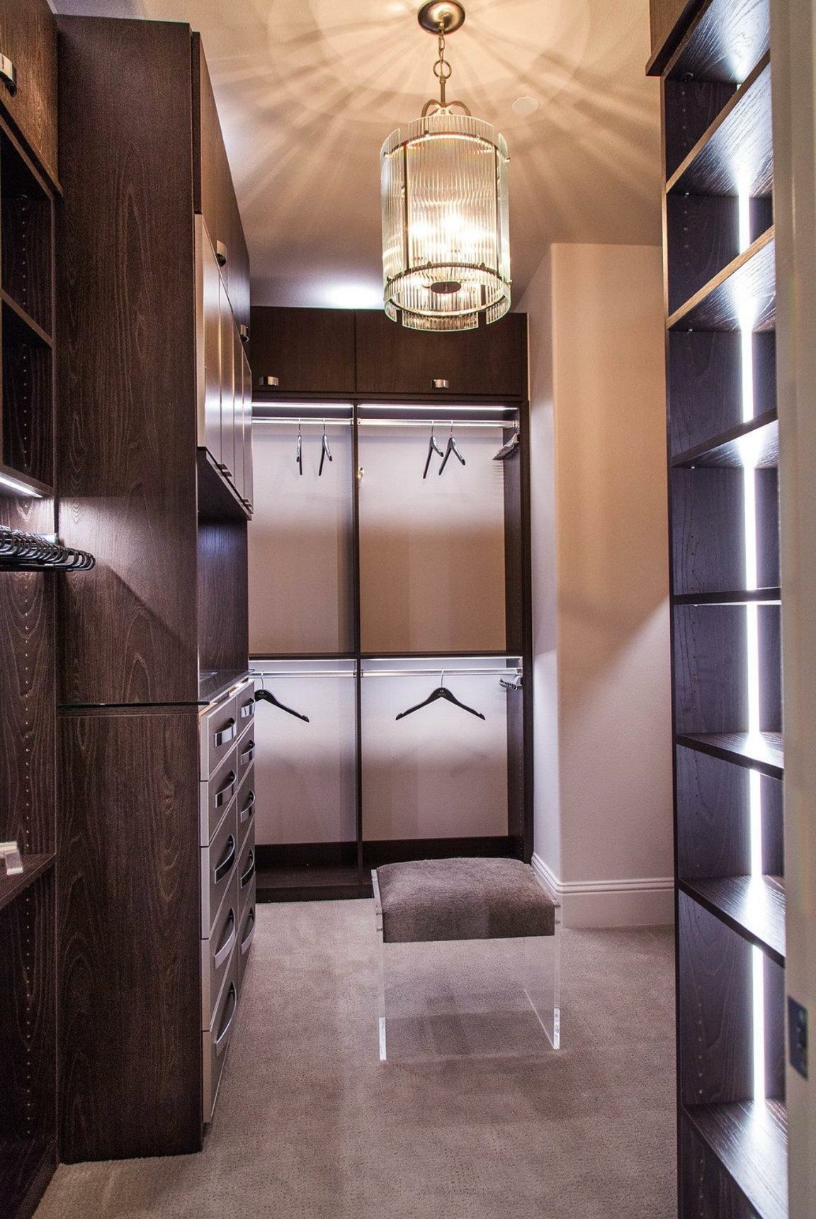 We were so excited to create custom his and hers closets for this Booth Brothers model home. These designs are all about elegance for guys and gals. #designyourhappyplace #closetenvy #closetgoals