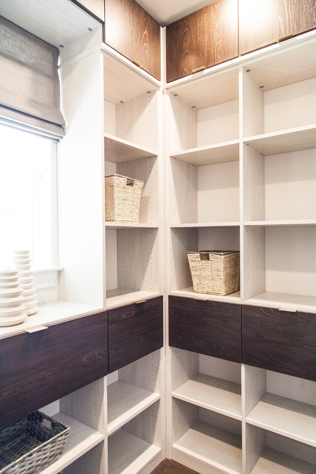 In addition to designing gorgeous his and her closets for the Booth Brothers model home we also got to design a stunning modern pantry. #designyourhappyplace #closetenvy